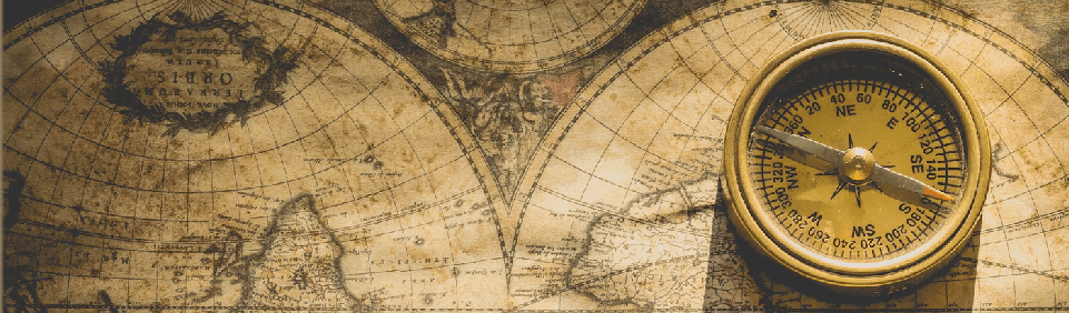 Image of a compass on a map, representing the Trader's Compass course.