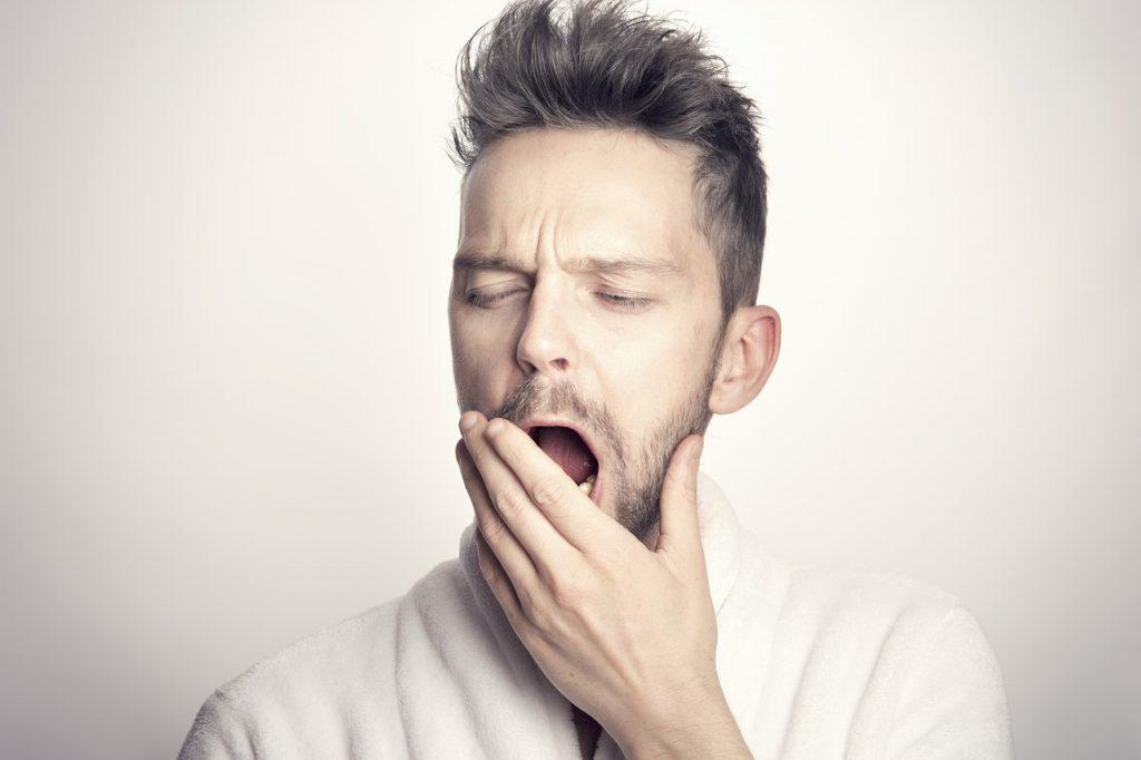 Man yawning out of boredom